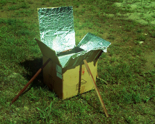Cardboard box solar oven cooking food