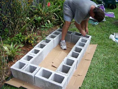 a raised bed garden using concrete blocks